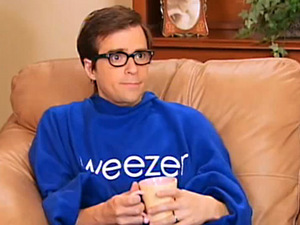 Rivers Cuomo modeling the Snuggie, tea in hand